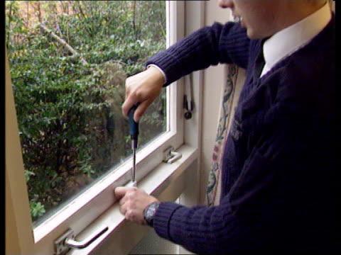 nottinghamshire ext van as carpenter philip burton walks around it hands lifting tool box out of van burton closing locking door with... - window sill stock videos and b-roll footage