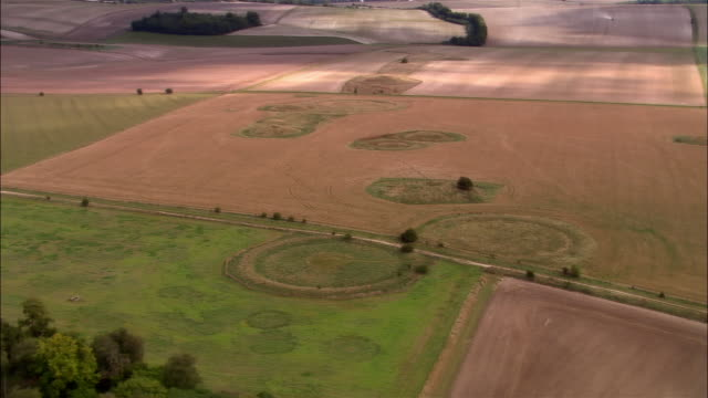aerial, burial mounds near stonehenge, wiltshire, england - archaeology stock videos & royalty-free footage
