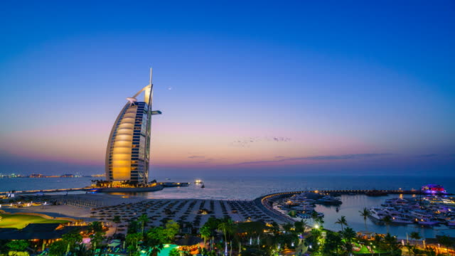 burj al arab, dubai, sunset time lapse - famous place stock videos & royalty-free footage