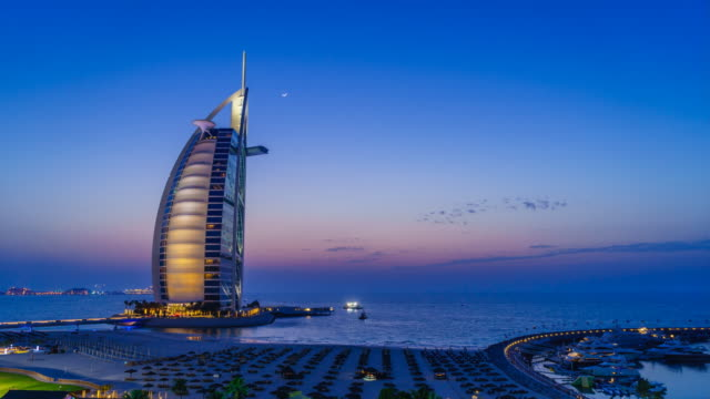 burj al arab, dubai, sunset time lapse - tourist stock videos & royalty-free footage