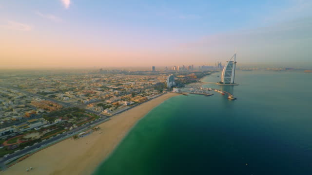 aerial burj al arab hotel at dusk - dubai stock videos & royalty-free footage