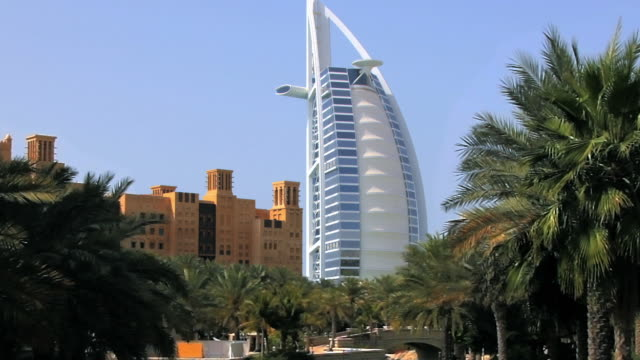 ws zo burj al arab hotel from souk madinat / dubai, united arab emirates - palm leaf stock videos & royalty-free footage
