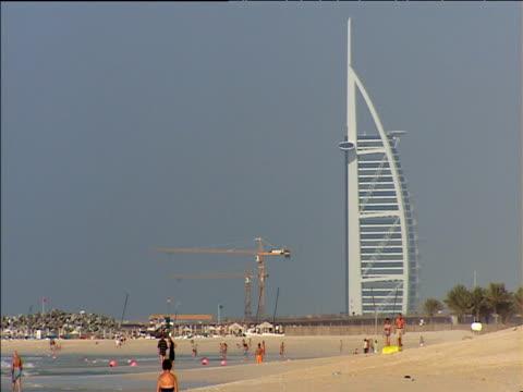 Burj Al-Arab hotel and neighbouring building site at end of beach Dubai