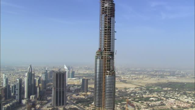 aerial burj dubai and construction site, dubai, united arab emirates - crane stock videos & royalty-free footage