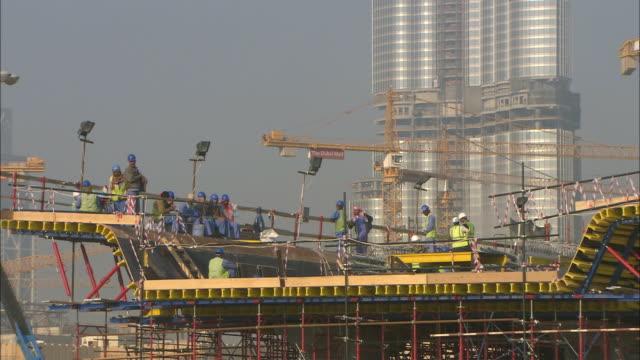 MS Burj Dubai under construction, workers having break, Dubai, United Arab Emirates