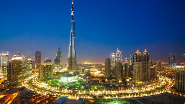 Burj Khalifa, Dubai cityscape, day to night time lapse