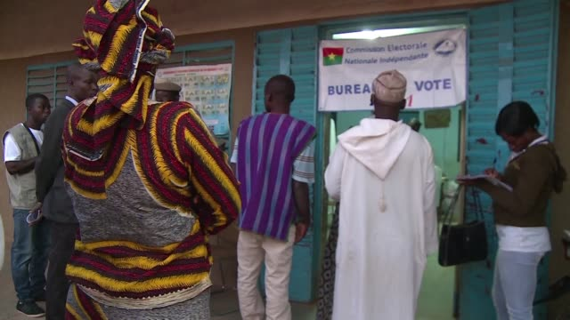 stockvideo's en b-roll-footage met burkina faso elects a new president and parliament sunday hoping to turn the page on a year of turmoil during which the west african nations people... - staatsgreep