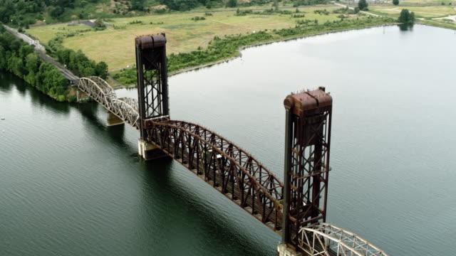 aerial burlington northern railroad bridge 5.1 across the willamette river in portland, oregon - river willamette stock videos & royalty-free footage