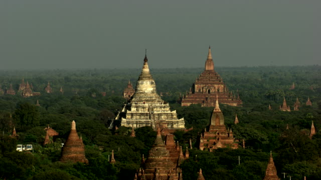 burma- myanmar : close-up of temples in the forest - bagan stock videos & royalty-free footage
