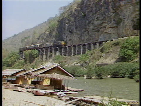 river kwai pleasure boat on river peter and brenda legard on boat train over wompo gorge viaduct legards watching train legards walking with reporter... - rail transportation stock videos and b-roll footage