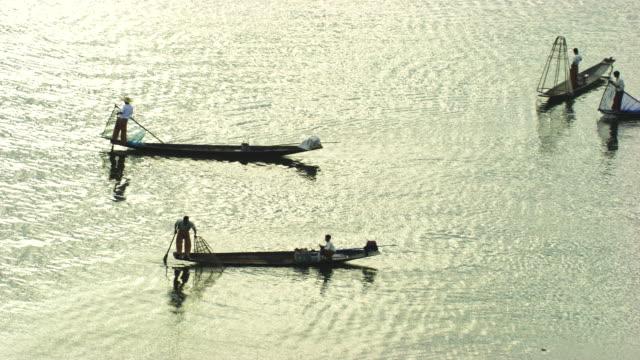 burma-myanmar : canoes with fishermen - myanmar stock videos & royalty-free footage