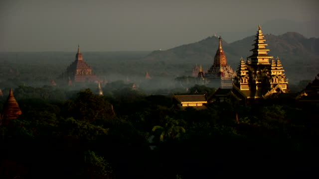 burma-myanmar : golden temple in the mist - myanmar stock videos & royalty-free footage
