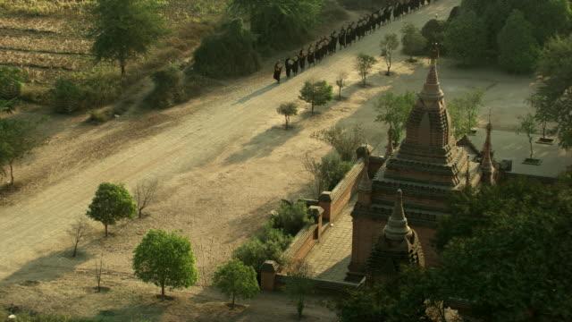 burma-myanmar : monks walking around the temple - bagan stock videos & royalty-free footage