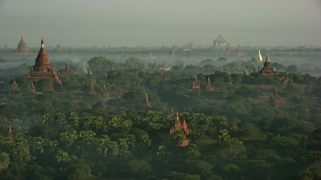 burma-myanmar : temple in morning mist with ballon - bagan stock videos & royalty-free footage