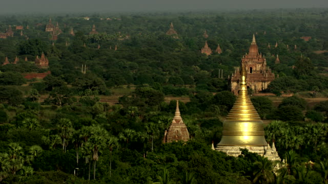 burma-myanmar : temple with golden roof in the forest - bagan stock videos & royalty-free footage