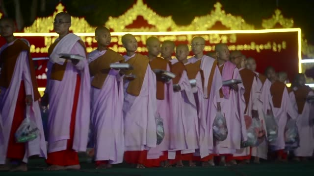 burmese devotees donate to monks at the shwedagon pagoda in yangon - monk stock videos and b-roll footage
