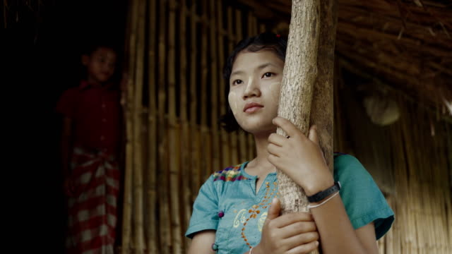 m/s burmese teenage girl in the door of her house - myanmar stock-videos und b-roll-filmmaterial