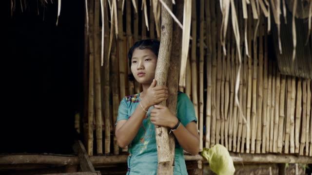 m/s burmese teenage girl in the door of her house - one teenage girl only stock videos & royalty-free footage