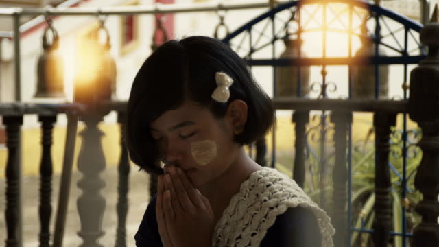 m/s burmese teenage girl praying in a buddhist temple - only teenage girls stock videos & royalty-free footage