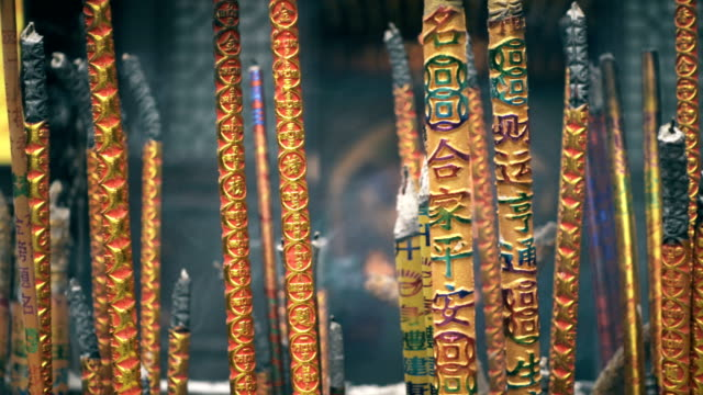burn incense in the temple,xi'an,china. - incense stock videos & royalty-free footage