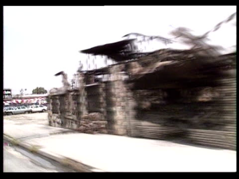 burned buildings and cars along streets in aftermath of la riots / los angeles california usa - 1992 stock videos & royalty-free footage