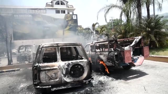 burned cars are seen in a hotel parking lot in port au prince after protesters set them on fire during a demonstration against the government's... - hispaniola stock videos & royalty-free footage
