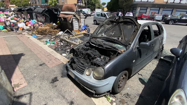 burned cars sit next to overflowing trash bins that were set on fire on the street as the city struggles with a garbage problem aggravated by the... - street name sign stock videos & royalty-free footage
