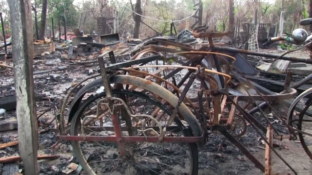 burned possessions and homes of rohingya muslims in rakhine state burma after they fled persecution - rohingya kultur stock-videos und b-roll-filmmaterial