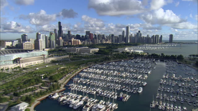 LOW AERIAL, Burnham Park Harbor and Chicago cityscape, Illinois, USA