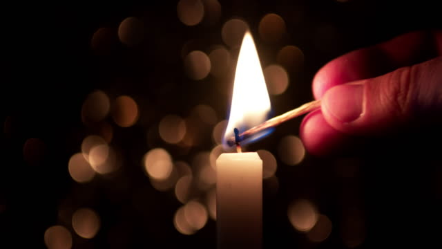 4k: burning a candle - candlelight stock videos and b-roll footage