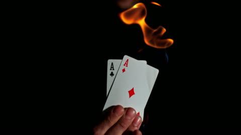 vídeos de stock, filmes e b-roll de slo mo burning aces - truque de mágica