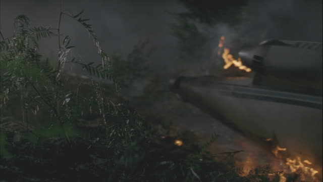 cu, burning airplane sliding down hill at night  - airplane crash stock videos and b-roll footage