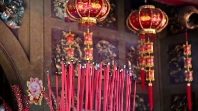 burning big red incense in chinese temple - monastery stock videos & royalty-free footage