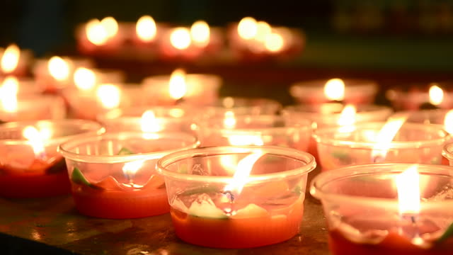 burning candle in the temple - oil lamp stock videos & royalty-free footage