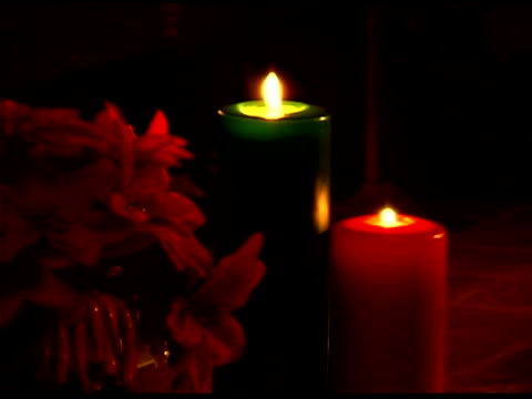 burning candles by poinsettia - see other clips from this shoot 1407 stock videos and b-roll footage