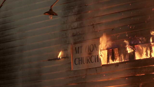 cu pan burning church and big fire flame coming through that church / france - 1989 stock videos and b-roll footage