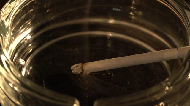 Burning cigarette with ashtray