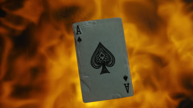 slo mo burning club ace card - magic trick stock videos and b-roll footage