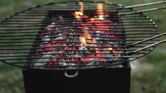 CU Burning coals in barbeque with barbeque grill / Corsept, Loire-Atlantique, France