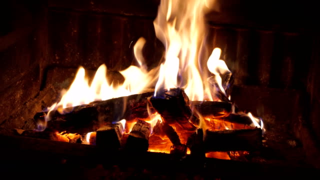 burning fire in fireplace - stone object stock videos & royalty-free footage