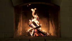 Burning Fire In The Fireplace. Wood And Embers In The Fireplace Detailed fire background.