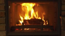 Burning Fireplace - a glowing fire in the stone fireplace to warm at night