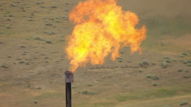 cu aerial burning flame at fracking site in campbell county  / wyoming, united states - fracking stock videos and b-roll footage