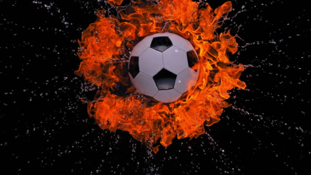slo mo ld burning football falling into water on black background - burning stock videos & royalty-free footage