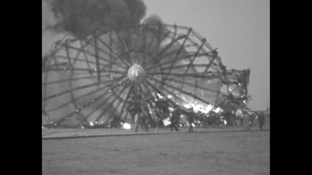 ws burning frame of the hindenburg after its explosion upon landing at naval air station lakehurst black smoke billows into air sailors and others... - human age stock videos & royalty-free footage