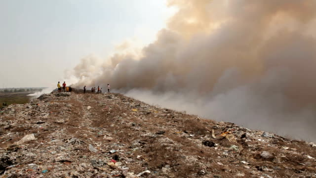 burning garbage heap of smoke from a burning pile of garbage - garbage stock videos & royalty-free footage