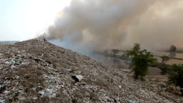 burning garbage heap of smoke from a burning pile of garbage - environmental damage stock videos & royalty-free footage