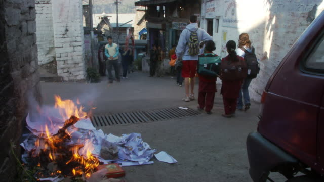 burning garbage on street - schoolgirl stock videos and b-roll footage