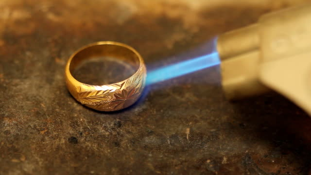 burning gold ring - bracelet stock videos and b-roll footage