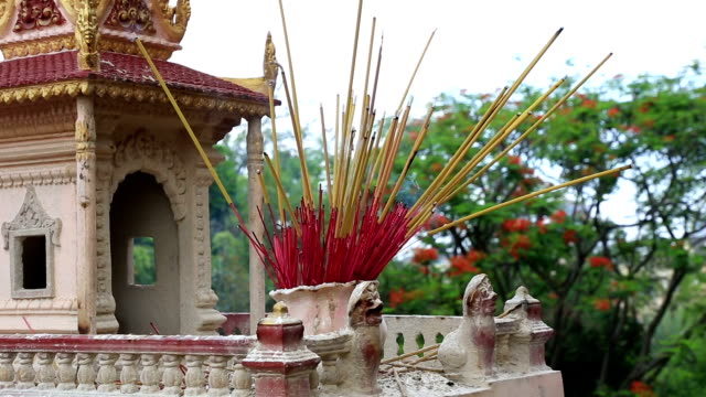 Burning incense In A Temple, Cambodia